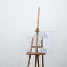 Giulio Paolini, Terra di nessuno, 2013-2014, Cavalletto, frammenti fotografici lacerati in teca di plexiglass, tela preparata, 91 x 80 x 220 cm | Foto: Antonio Maniscalco