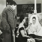 FRIDA. VIVA LA VIDA, Bernard Silberstein (1905 - 1999), United States, Diego Rivera Watching Frida Kahlo Paint a Self Portrait, 1940 Circa, Stampa alla gelatina d'argento, Cincinnati Art Museum, Gift of the Artist, 1986 / 570 | © Edward B. Silberstein | Courtesy of Ballandi Arts e Nexo Digital 2019