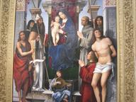 immagine di Pala Feliciti - Madonna col Bambino in trono e i Santi Giovanni Battista, Monica, Agostino, Francesco d'Assisi, Proco, Sebastiano, il donatore Felicini e un angelo musicante