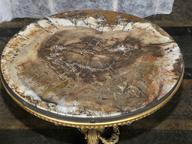 immagine di Tavolino con piano in legno pietrificato