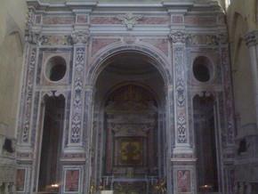 immagine di Crocifisso adorato da san Francesco e da altri santi francescani e Madonna col Bambino e sante  francescane