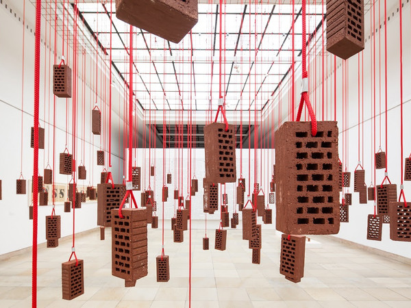 Kendell Geers, HangingPiece, 1993, brick, rope and metal hooks, dimensions variable, installation view at Haus der Kunst, Munich