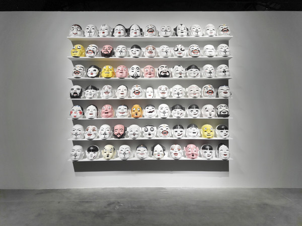 Qiu Zhijie, The Greeting, 2013, paper masks, silicone masks. Installation view at Anren Biennale, 2017