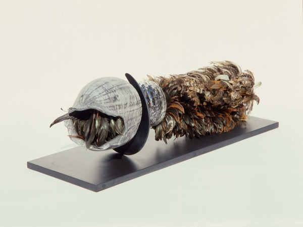 Liliane Lijn, Soften the Mouth, Zinc blown glass, feather dusters, anodised aluminium, black Italian honed slate base, 1987 – 1990