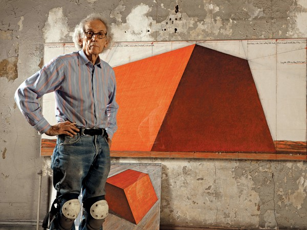 Christo in his studio with a preparatory drawing for The Mastaba