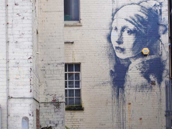 Girl with a Pierced Eardrum, Banksy