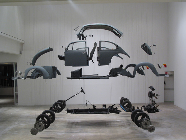 Damián Ortega, Cosmic Thing, 2002. Beetle 83', stainless steel, wires and plexiglass Variable dimensions. Courtesy The Museum of Contemporary Art, Los Angeles, purchased with funds provided by Eugenio López and the Jumex Fund for Contemporary Latin America Art