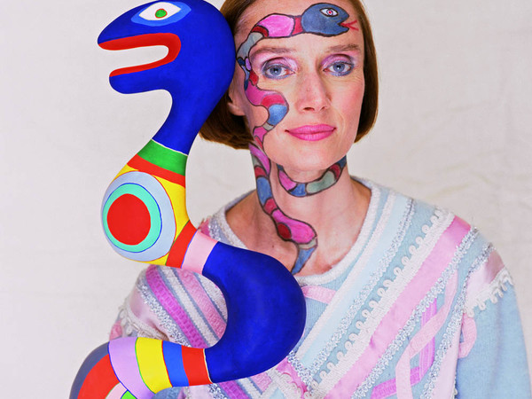 Niki De Saint Phalle with her sculpture, 1983
