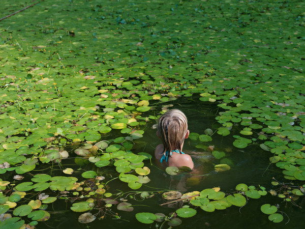 Lucas Foglia, Maddie with Invasive Water Lilies